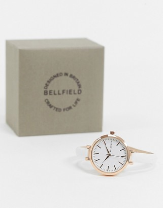 Bellfield watch with skinny white stap and rose goal dial