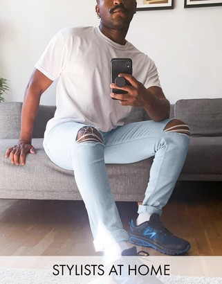 ASOS DESIGN skinny jeans in light wash blue with knee rips