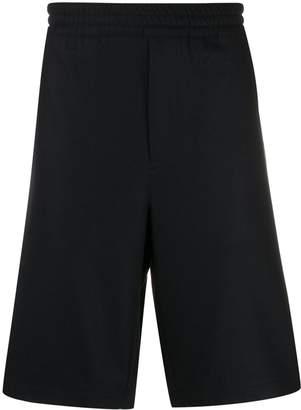 Prada logo patch woven shorts