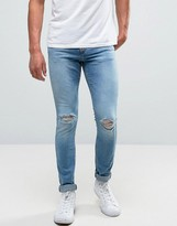 Pull&Bear Super Skinny Jeans With Knee Rips In Mid Wash