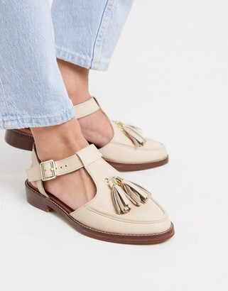Asos DESIGN Moving leather tassel flat shoes in bone