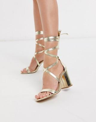 London Rebel tie leg heeled sandals in gold