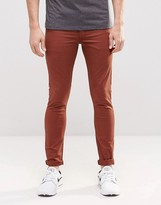 Asos Extreme Super Skinny Jeans In Rust
