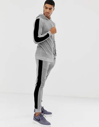 Asos Design DESIGN tracksuit muscle hoodie/ super skinny sweatpants in velour with side stripes in gray marl