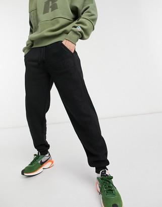 Russell Athletic fleece trackies in black