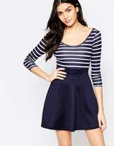 Club L Cross Back Skater Dress With Stripe Top And Contrast Skirt