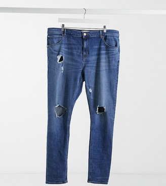 ASOS DESIGN Plus 'Responsible Edit' super skinny jeans in mid wash with knee rips