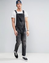 Asos Denim Overalls With Rips And Turn Ups In Washed Black