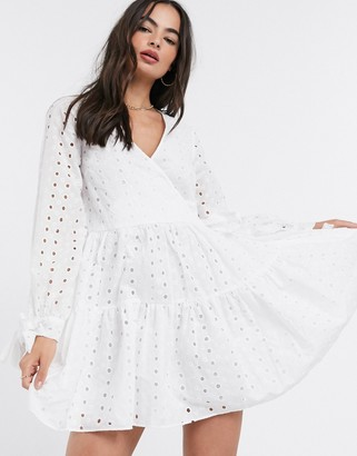 ASOS DESIGN tiered trapeze wrap mini dress in broderie in white