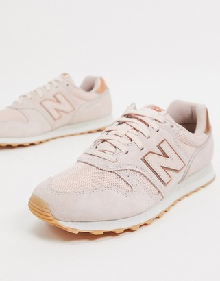 New Balance 373 sneakers in pink and rose gold