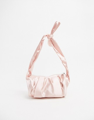 Glamorous unstructured satin knot handle baguette grab bag in ash rose