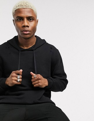 ASOS DESIGN oversized hoodie with distressing in washed black