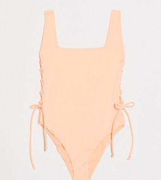 ASOS DESIGN petite minimal sleek lace up side square neck swimsuit in fluro peach