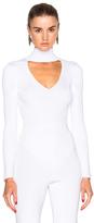 Cushnie et Ochs Turtleneck Bodysuit in White.