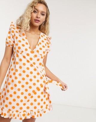 Lost Ink wrap front smock mini dress in tonal polka dot