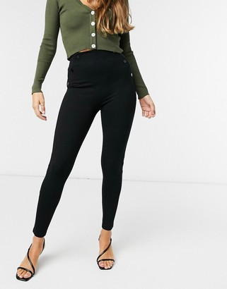 Stradivarius leggings with faux leather side seam detail in black