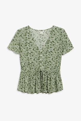Monki V-neck blouse with ruffle hem