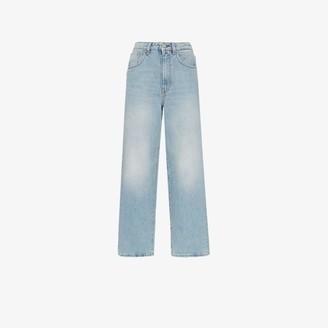 Totême Light Wash Flared Jeans