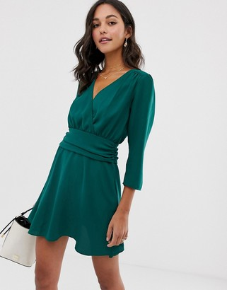 Asos Design DESIGN wrap mini dress with ruched skirt-Green
