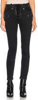 Unravel Lace Up Skinny Jeans in Black.