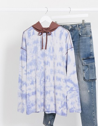ASOS DESIGN oversized longline long sleeve hooded t-shirt with blue tie dye wash
