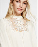 Express crocheted lace bib mock neck blouse