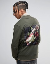 Criminal Damage Jersey Bomber Jacket In Khaki With Floral Back Print