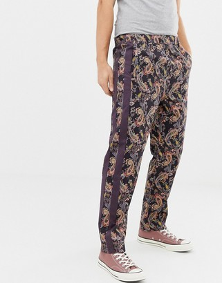 ASOS DESIGN relaxed pants in paisley print with side tape