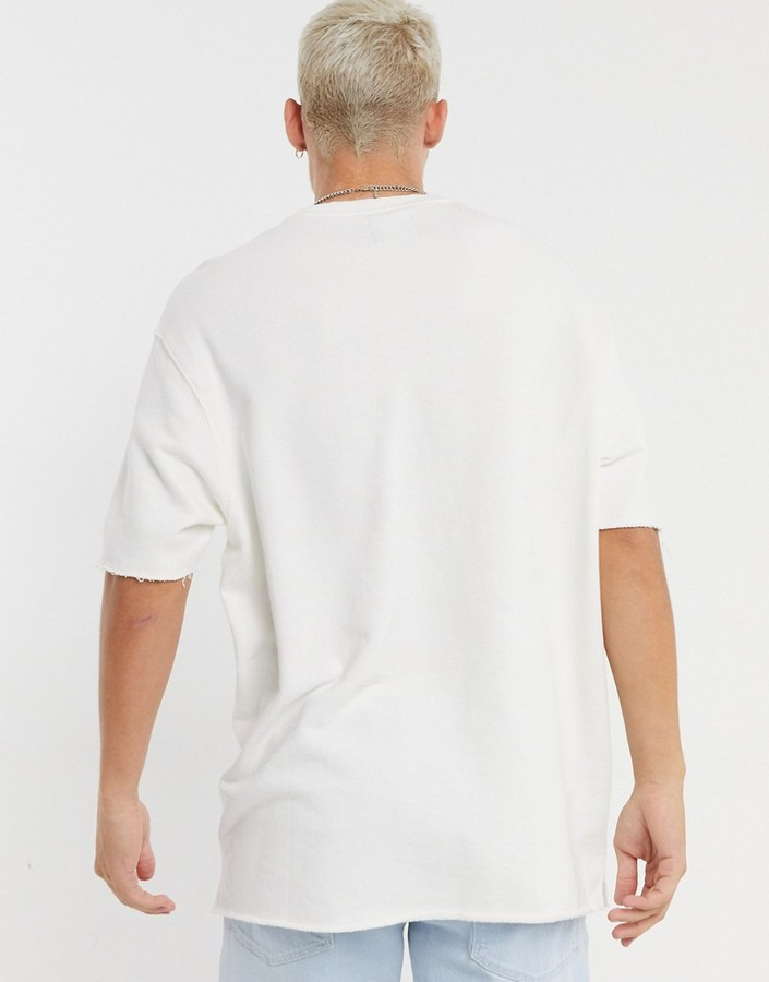 Thumbnail for your product : Bershka loose fit t-shirt with raw edge in white