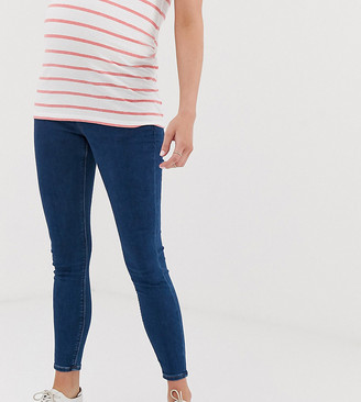 ASOS DESIGN Maternity high rise ridley 'skinny' jeans in rich mid blue wash with under the bump waistband