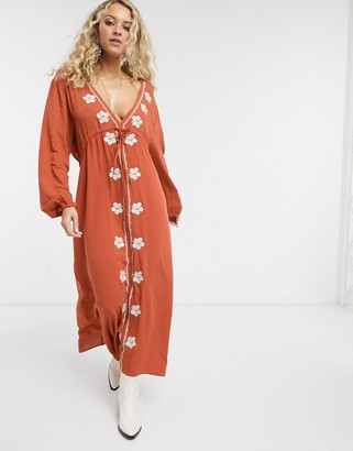 En Creme midi dress with plunge front and embroidered detail