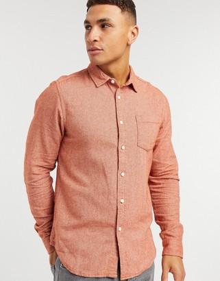ASOS DESIGN regular flannel shirt in rust