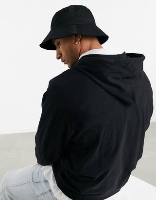 ASOS DESIGN wide brim bucket hat in black cotton