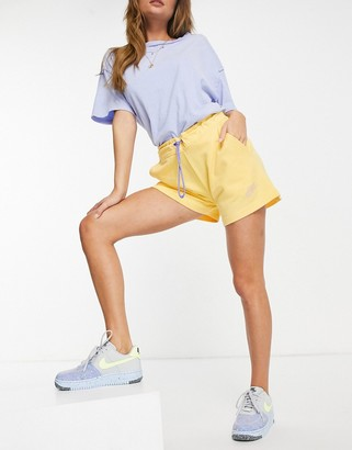 Nike Icon Clash shorts in pale yellow