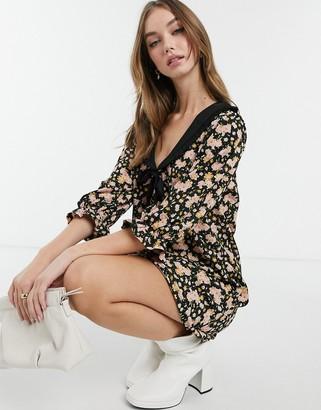 ASOS DESIGN mini swing dress with black contrast collar in black base floral