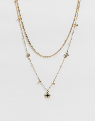 ASOS DESIGN multirow necklace with celestial star charms and faux black stone in gold tone