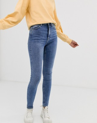 Weekday organic cotton high waisted skinny jeans in mid blue