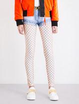Moschino Short and fishnet-print woven leggings