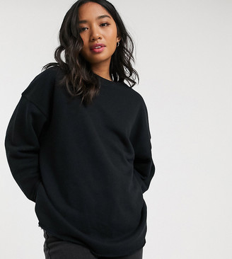ASOS DESIGN Petite textured oversized sweatshirt in black
