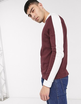 ASOS DESIGN organic long sleeve t-shirt with contrast shoulder panel in burgundy
