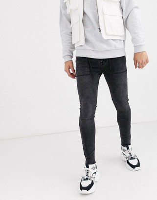 ASOS DESIGN spray on jeans in power stretch with drawstring waist in washed black