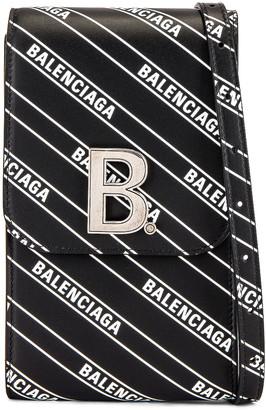 Balenciaga B Phone Holder in Black & White | FWRD