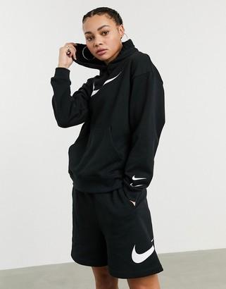 Nike high waist longline swoosh shorts in black