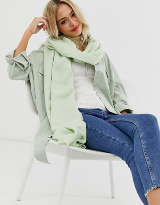 ASOS DESIGN plain lightweight winter pastel long scarf with raw edge in green