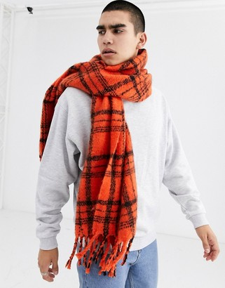 Asos DESIGN blanket scarf in orange and black brushed check with tassels