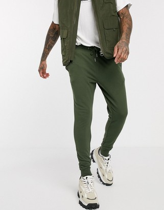 ASOS DESIGN super skinny lightweight joggers in dark green