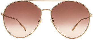 Givenchy Round Sunglasses in Gold & Brown Gradient | FWRD