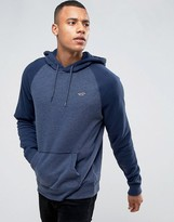 Hollister Icon Logo Hoodie Tonal Raglan Sleeves Regular Fit In Navy Marl