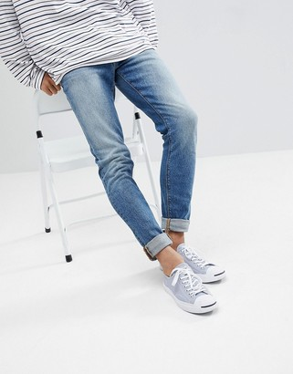 ASOS DESIGN skinny jeans in vintage mid wash blue
