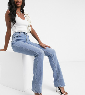 Asos Tall ASOS DESIGN Tall high rise '70's' kick flare in midwash